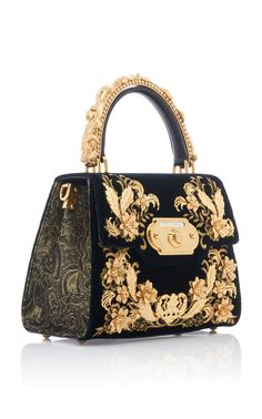 Dolce & Gabbana's bag is crafted from velvet with a gilded brocade design and floral embellishments. It's fitted with dual top handles and a gold-tone logo-embellished front flap. Wear yours across the body with its detachable shoulder strap. Cheap Purses, Cheap Handbags, Cheap Bags, Cute Purses, Purses And Handbags, Unique Purses, Dior Purses, Handmade Purses, Small Handbags
