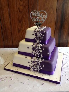 Cadbury purple wedding cake with bespoke topper
