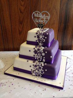 Cadbury purple wedding cake with bespoke topper