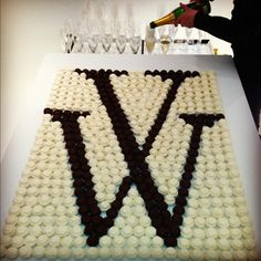 I LOVE this idea! Cupcakes displayed in your monogram.  Cute!  Rehearsal dinner? Wedding shower?