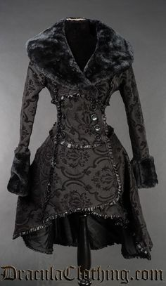 A shorter version of the black evil queen coat.<br />  <br />  A rich, black and black cotton jacquard that we custom made. It is made in two layers, the first layer has a slightly velvety look, the black is woven over the black base material to create a super thick heavy brocade fabric.<br />  <br />  The coat weighs more than two kilos in most sizes.<br />  <br />  The coat is 107cm long or around 42 inches from the neck and to the longest point in the back.
