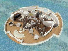 Round floating retreat, cutaway view. The 110 sq meter deck provides room and amenities for six (in the luxury model). The attached baths have a space-saving water closet hanging off the tub. The core of the space is a large kitchen and bar, with a center spiral staircase leading down to the observation bulb. The lowest room lets the owners view their surroundings underwater.