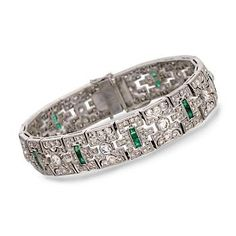 http://www.ross-simons.com/products/774981.html    C. 1990 Vintage 2.40 ct. t.w. Emerald and 6.40 ct. t.w. Diamond Bracelet In 18kt White Gold. 6.75""