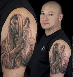 http://www.tattoobite.com/wp-content/uploads/2014/04/jesus-portrait-tattoo-on-biceps-for-men.jpg