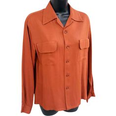Beautiful men's mid 1940s to mid 1950s long sleeve rayon shirt in rich, rusty, amber. Size Small. These lightweight, rayon shirts are very, very hard