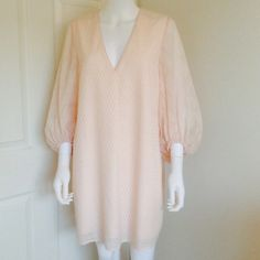 H&M pink flowy tunic dress Size M Super cute petal pink flowy tunic dress from H&M with poet sleeves and a cute pattern on the fabric texture. Size medium. H&M Dresses