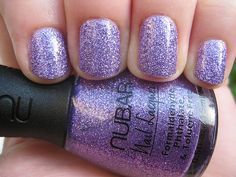 Makes me think of Laura...purple sparkle nails