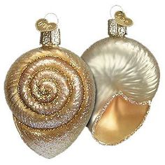 "$7.85-$7.99 Spiral Shell Ornament - This beautiful glass ornament was carefully mouth-blown into a finely crafted mold. Then a hot solution of liquid silver was poured inside. Finally, the ornament was delicately hand painted with many bright lacquers and glitters for you to enjoy! 3"" Tall http://www.amazon.com/dp/B002CE2Y42/?tag=pin2wine-20"