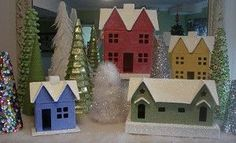 Create your own Vintage Christmas Village to display in your home this holiday season. This fun Christmas craft features small cottages and houses surrounded by a collection of beautiful vintage Christmas trees. Diy Christmas Village, Vintage Christmas Crafts, Merry Christmas, Christmas Villages, Christmas Home, Holiday Crafts, Christmas Holidays, Christmas Decorations, Christmas Ornaments