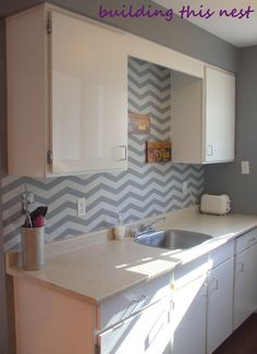 How fun is this chevron painted backsplash? via building this nest