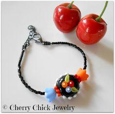 Fried Egg Poppy flower Bracelet, Lampwork glass flower bead, Lucite flower beads, seed beads, square glass beads, lobster claw hook, black chain, crimp beads