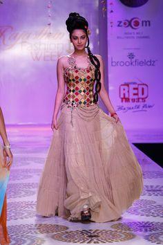colorful lehengha with a corset top, rajasthan fashion week 2012 #lehenga #choli #indian #shaadi #bridal #fashion #style #desi #designer #blouse #wedding #gorgeous #beautiful