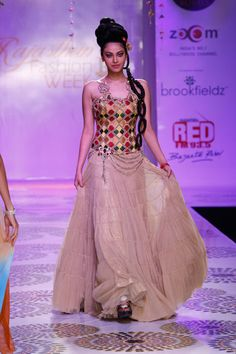 colorful lehengha with a corset top, rajasthan fashion week 2012 #lehenga #choli #indian #shaadi #bridal #fashion #style #desi #designer #blouse #wedding #gorgeous #beautiful