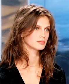 Mussed, messy, tousled, textured, long layered locks. Pretty much perfectly undone, effortless, air dried hair.   LA COOL & CHIC