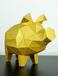 One piggy bank in gold if that doesn't say riches! This paper figure in low poly design is especially pleased about your saving aspirations and safeguards your additional bills and coins conscientiously. #PaperTrophy