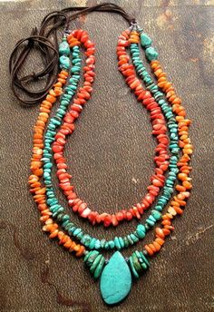 @-->----- { .n e c k l a c e s. } -----<--@  ~ in this far off sunset you'll find oodles and oodles of highly polished dark orange coral, tangerine coral, and natural turquoise nuggets stacked a