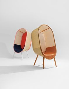 the chairis the result of a fusion between the beauty in rattan fabric and a curvy, unified wood silhouette.