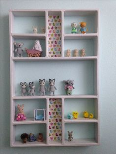 Storage display for Calico Critters Sylvanian Family animals from thrift store shelf.
