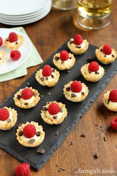 Mini Phyllo Cups with Coconut Cream, Raspberries, and Dark Chocolate from afarmgirlsdabbles.com