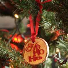 How to make your own rustic glam glitter wood tag ornaments.