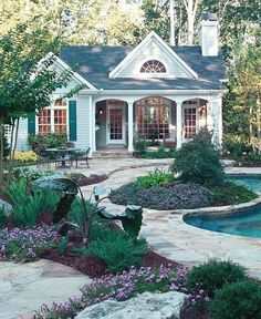 cute cottage house with porch, pool and gardens