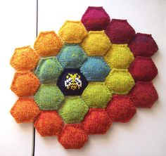 http://www.ravelry.com/projects/baroquepurls/the-beekeepers-quilt