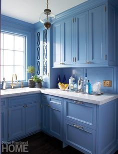 Blue butler's pantry features a window framed with blue casings positioned above a sink with a brass gooseneck faucet mounted to a gray marble countertop over blue cabinets finished with brass knobs. Glass Front Cabinets, Blue Cabinets, Grey Kitchen Cabinets, Upper Cabinets, Pantry Cabinets, Kitchen Pantry, Kitchen Reno, Blue Shelves, Custom Pantry