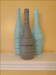 wine bottle decor: place rubber bands around wine bottles, spray paint, then remove rubber bands. Easy!