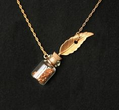 Doesn't every writer need a quill and ink necklace? Feather Quill Ink Well Pendant Vintage Style. $23.50, via Etsy.