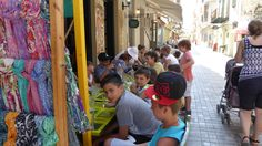 A group of children having lunch in Nauplion, Greece.