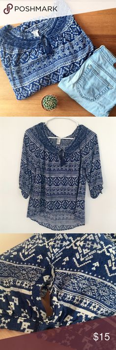 Flowy Boho Peasant Top This is a great top with a navy blue and white Aztec pattern. It is slightly shorter in the front and longer in the back. Has a tassel tie at the neck and 3/4 sleeves with cute keyholes and brass buttons. Size medium but would fit a small, too. Forever 21 Tops
