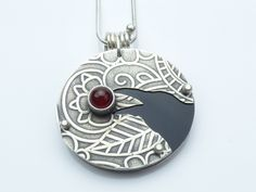 Hand cut, rolled and pierced argentium silver Raven, bezel set ...
