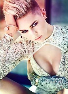 20 Female Celebrities You Didn't Know Smoked Cigarettes: Miley Cyrus - http://lili.farm/#!details/female-celebrities-you-didn't-know-smoked-cigarettes