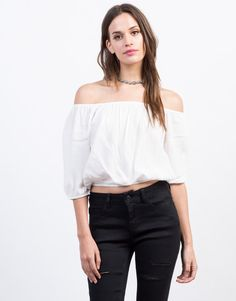 Sweet and summery. This Cropped Off-the-Shoulder Top comes in a black or ivory color of your choice. Pair this crop top with some high waisted frayed denim shorts and ankle booties for a summer day out or to any music festivals.
