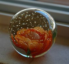 Glass paper weight by starscomeout7, via Flickr