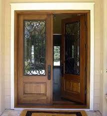 P101i q puerta doble de entrada de madera con reja de for Puertas doble hoja interior madera