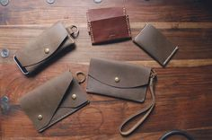craftandlore:  Some of the leather goods currently on my bench top. Some simple card holders (a couple in Horween), a larger version of the 2 pouch lassie wallet. Large enough to hold your mobile in a pouch. A mid sized clutch with a wrist lanyard should be in the shop soon. I'm also testing an iPhone slip with a pouch and keyring. There's a few more tweaks I need to make to the design before that one will be ready, plus more time needed for field testing.