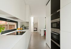 I like the flat look of these white cabinets. Not painted wood. What is it? Some sort of composite material?
