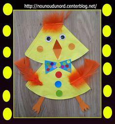 Poussin de Pâques réalisé par Gaspard bientôt 4 ans avec des filtres à café peint en jaune