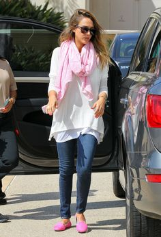 While running errands in Beverly Hills, Jessica Alba coordinated her bright neon pink Charles Philip smoking slippers with a pink scarf, then finished off with skinny jeans and a white blouse.