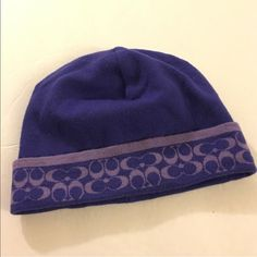 Coach Purple Beanie This is a preloved Coach beanie 100% authentic.  Made of 100% merino wool.  Signature Coach design.  Preloved but in great condition. Coach Accessories Hats