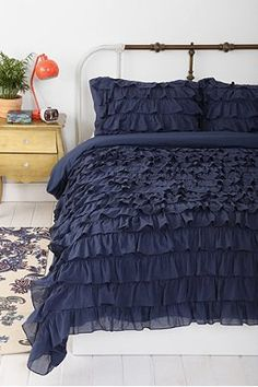 Waterfall Ruffle Navy Blue Duvet Cover - Curtains of the same color without the ruffles to match?