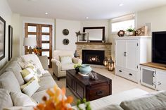 this one seems like a realistic size future living room, with a great fireplace!