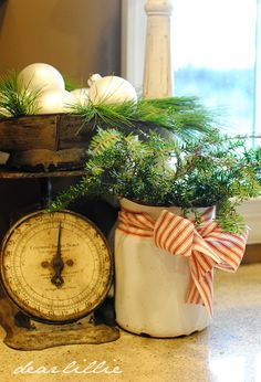 Loving the antique scale used to hold ornaments!  Via Dear Lillie