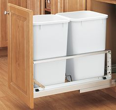 Recycle Center - Full extension, heavy duty, bottom-mount hardware that supports 2 recycle or waste bins.  This hardware attaches to the cabinet door and also features a soft close.  Bellmont #Cabinets