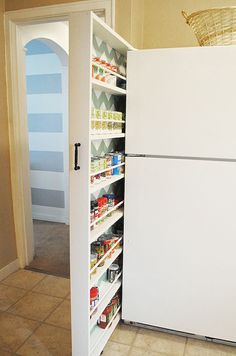 #DIY your way to more #kitchen space with this hideaway rolling pantry.
