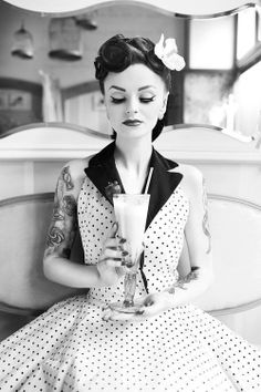 pinup with tattoo, milkshake and dotted dress
