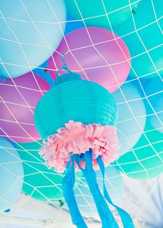 – DIY paper lantern jellyfish with crepe paper tentacles + hanging fish nets filled with balloons