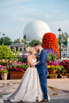Disney Fairy Tale Wedding bridal portraits inside Disney's Epcot Italy Pavilion with Spaceship Earth in the background