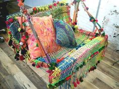 Colorful weaving on this swing! from Bohemian Interiors.